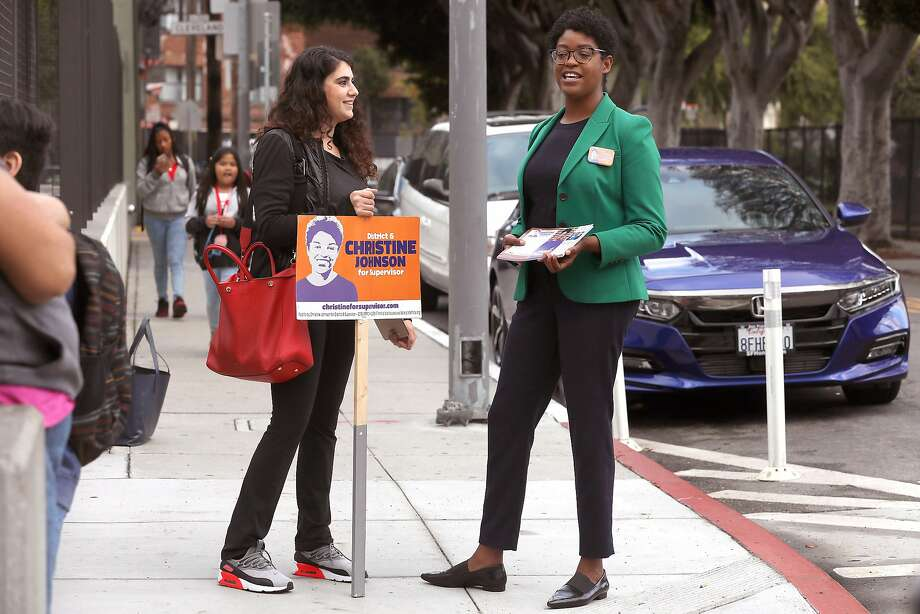 Candidate Christine Johnson (right), with her supervisorial campaign coordinator, Miriam Zouzounis, at Bessie Carmichael Elementary School. Photo: Liz Hafalia / The Chronicle