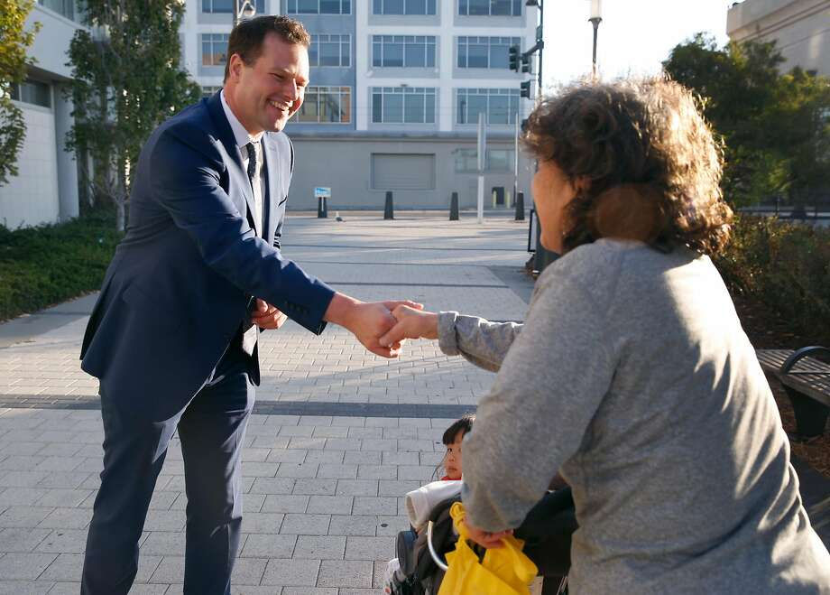 Matt Haney, candidate for supervisor, greets a resident in District Six's Mission Bay neighborhood. Photo: Paul Chinn / The Chronicle