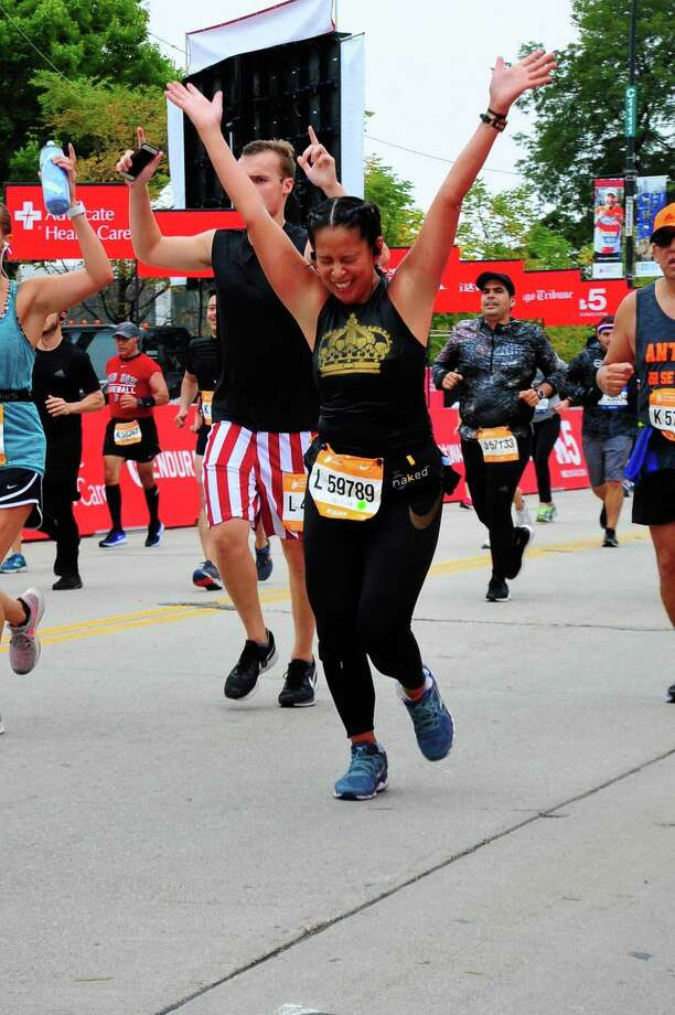 Selina Santos, 42, celebrates at the finish line of the Chicago Marathon on Sunday, Oct. 7, 2018. Santos is a Wilton resident and a survivor of heart disease. Photo: Contributed Photo