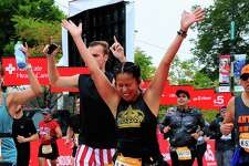 Selina Santos, 42, celebrates at the finish line of the Chicago Marathon on Sunday, Oct. 7, 2018. Santos is a Wilton resident and a survivor of heart disease.