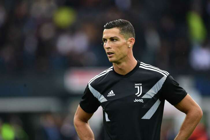 TOPSHOT - Juventus' Portuguese forward Cristiano Ronaldo trains prior to the Italian Serie A football match Udi-nese Calcio vs Juventus FC at the Dacia Arena stadium in Udine on October 6, 2018. (Photo by Miguel MEDINA / AFP)MIGUEL MEDINA/AFP/Getty Images