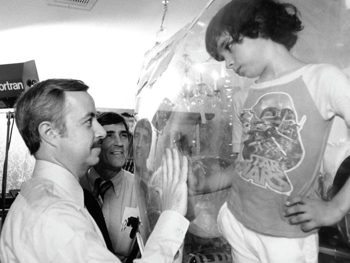Dr. William Shearer visits with his patient, David Vetter, at Texas Children's Hospital in 1979.