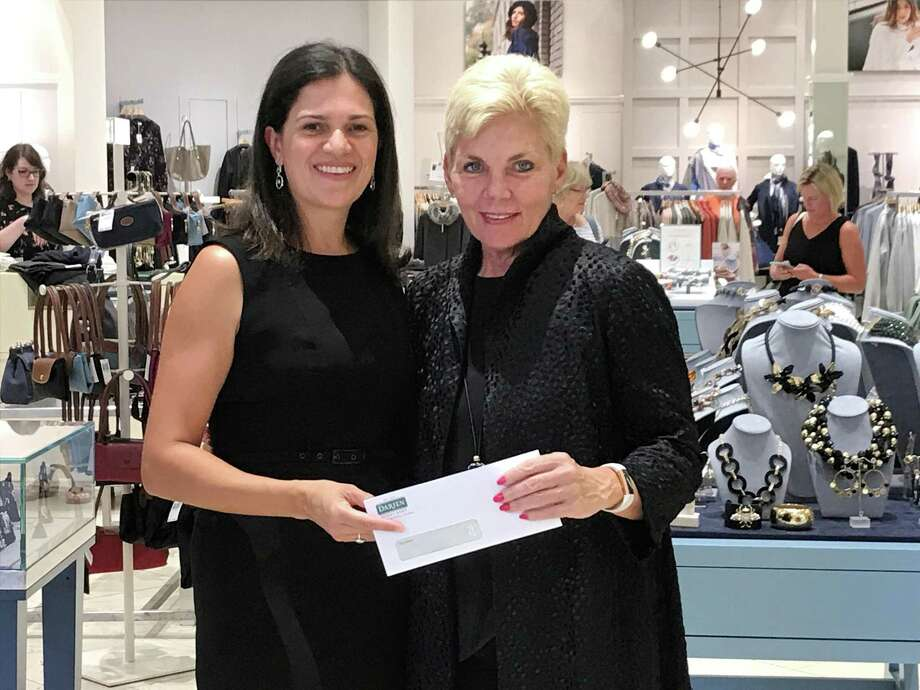 BYO Co-Cair Paola Sordoni accepting a donation from Darien Sport Shop owner Gina Zangrillo. Photo: /contributed Photo