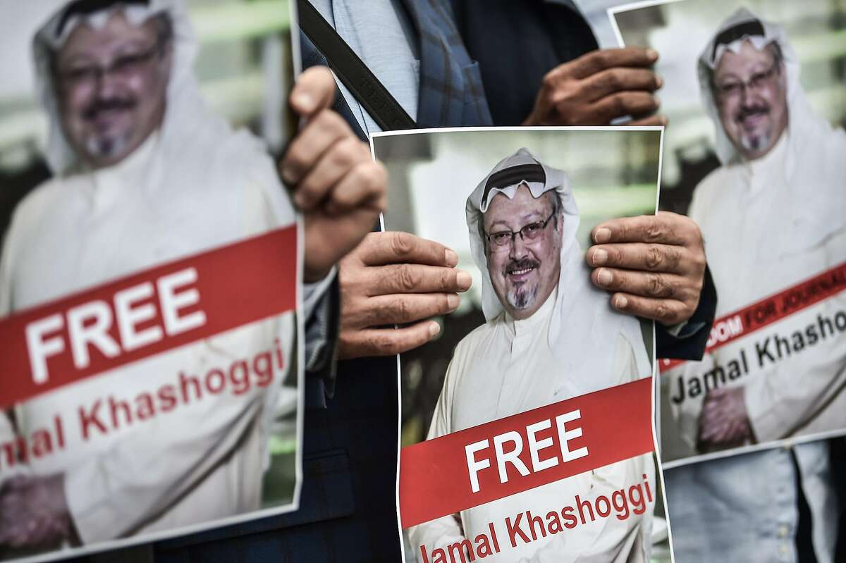 """(FILES) In this file photo taken on October 8, 2018 protestors hold pictures of missing journalist Jamal Khashoggi during a demonstration in front of the Saudi Arabian consulate in Istanbul. - Allegations that Saudi Arabia killed a journalist inside its Istanbul consulate have forced Donald Trump into a position he never expected -- raising human rights with the kingdom he has steadfastly supported. Saudi Arabia was the first foreign destination as president for Trump, who has lavished praise on its ambitious crown prince, Mohammed bin Salman, and closely allied himself with the kingdom in a push to isolate the Sunni state's regional rival Iran.But Trump said October 8, 2018 he was """"concerned"""" after a Turkish government source said Jamal Khashoggi, a prominent opinion writer living in the United States and who contributes to The Washington Post, was killed after he entered the Saudi consulate. (Photo by OZAN KOSE / AFP)OZAN KOSE/AFP/Getty Images"""