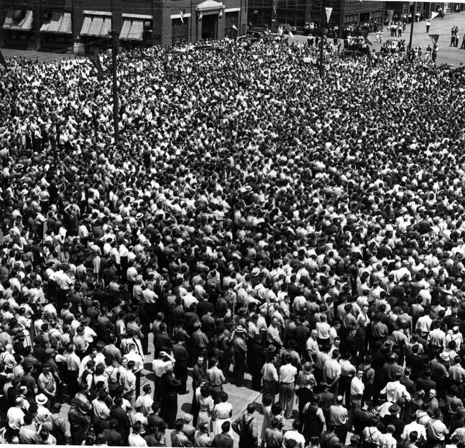 "A crowd estimated at 20,000 General Electric workers at the Schenectady plant to see the presentation of the Navy ""E Award"" in June, 1942. (Times Union archive)"