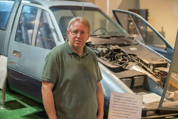 """The (GE) plant was almost like a city in itself,"" said Chris Hunter, director of archives and collections at the museum of Innovation and Science  in Schenectady. He is standing in front of GE's first electric car. (Skip Dickstein/Times Union)"