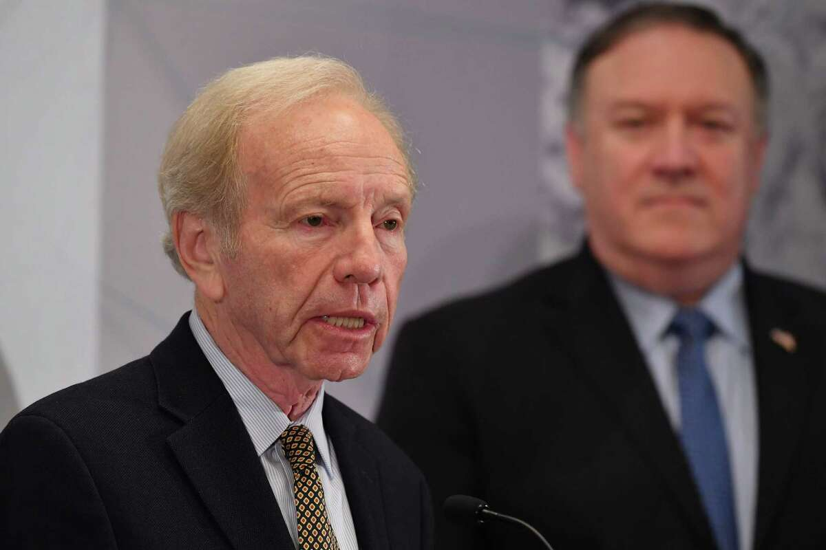 US Senator Joe Lieberman (L) introduces US Secretary of State Mike Pompeo (R) as he arrives to speak at the United Against Nuclear Iran Summit in New York on September 25.