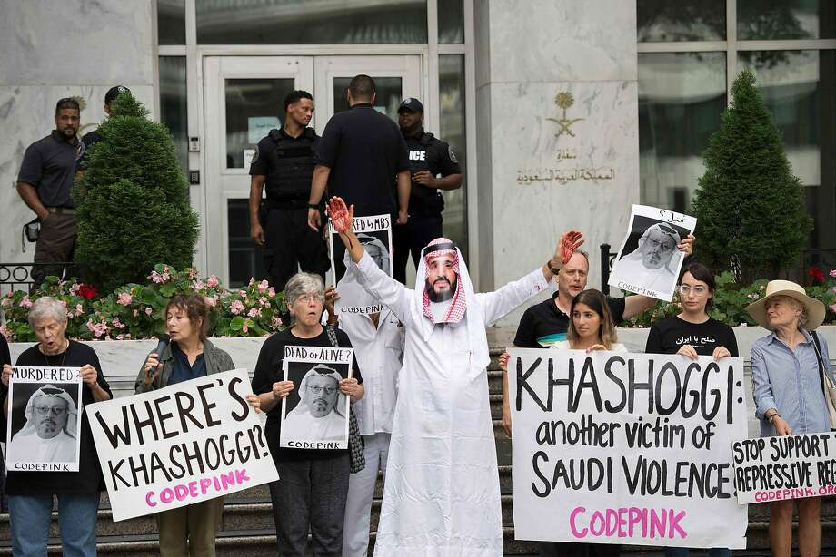 A demonstrator dressed as Crown Prince Mohammed bin Salman with blood on his hands protests outside the Saudi Embassy in Washington, D.C. Photo: Jim Watson / AFP / Getty Images