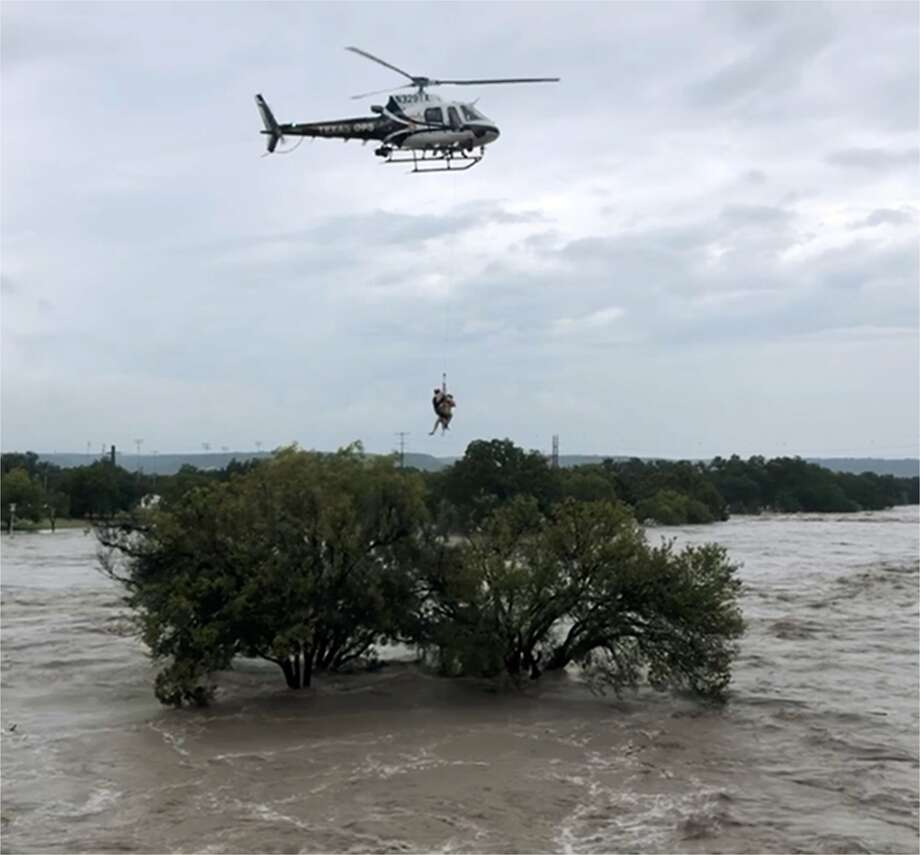 Texas DPS helicopter crew extracts a person who sought refuge in a tree as the South Llano and Llano rivers near Junction flooded early Monday. The flooding caused temporary closure of a handful of Hill Country state parks including popular South Llano River State Park. Photo: Texas Parks And Wildlife Department
