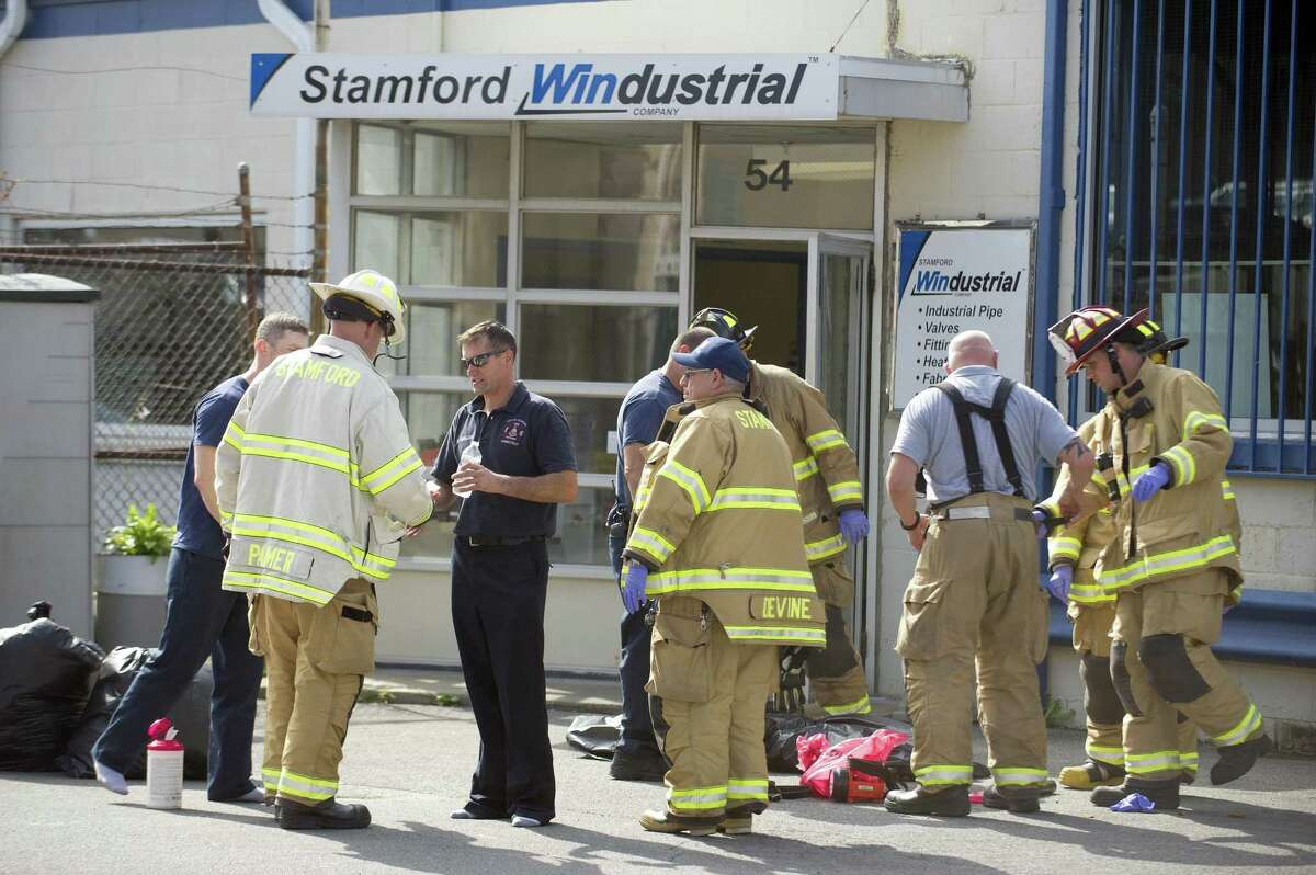 Firefights and police respond to a call of a roof repairman falling 30-feet through a skylight at Stamford Windustrial Co. on Sunnyside Ave. in west Stamford, Conn. on Wednesday, Oct. 10, 2018.