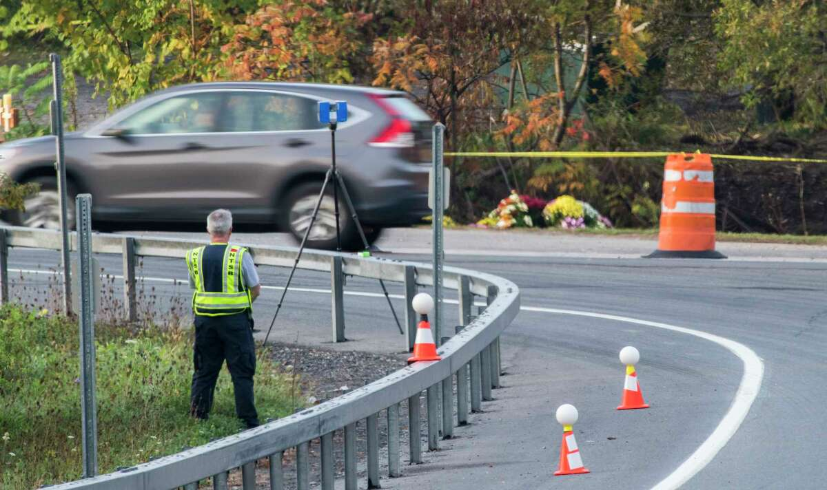 A investigator from the National Transportation and Safety Board continues his investigation of Saturday's limousine accident at the intersection of Routes 30 and 30A Wednesday Oct.10, 2018 in Schoharie, N.Y. (Skip Dickstein/Times Union)