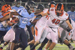 Edwardsville's Adam Foster chases down the Belleville East running back during last Friday's game in Belleville.