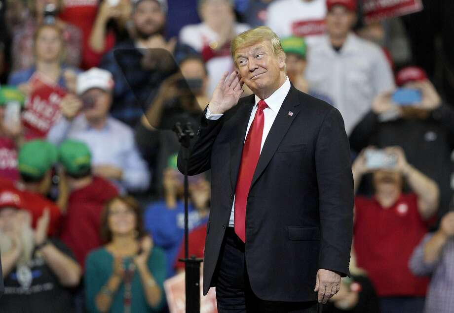 President Trump gestures to the crowd at a recent rally in Council Bluffs, Iowa — his 32nd since his inaugural. Trump ties his success to the adulation of his most loyal fans. Photo: Nati Harnik / Associated Press