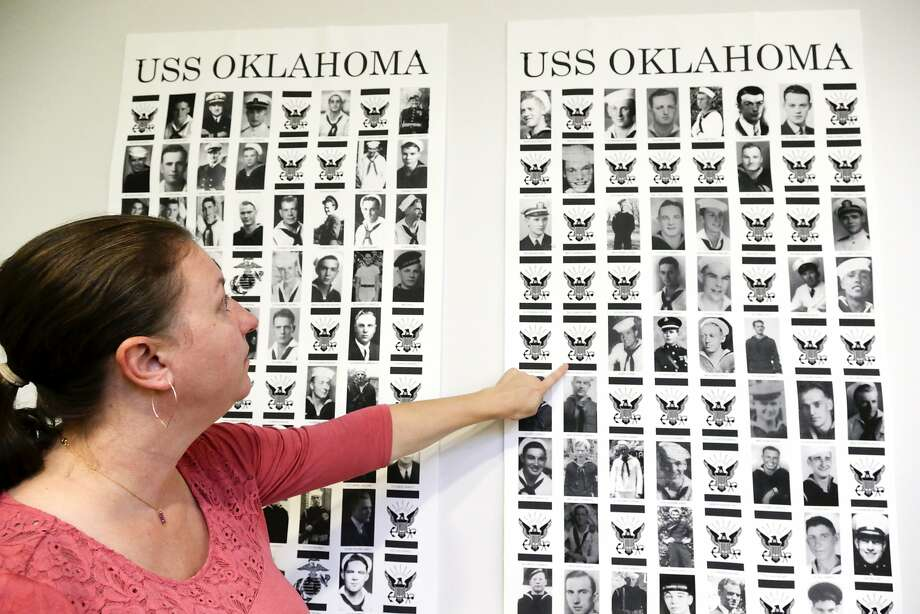 Forensic anthropologist Carrie Brown points to the victims of the battleship Oklahoma, sunk at Pearl Harbor. An increase in identifications has led to a surge of memorial services and burials. Photo: Nati Harnik / Associated Press