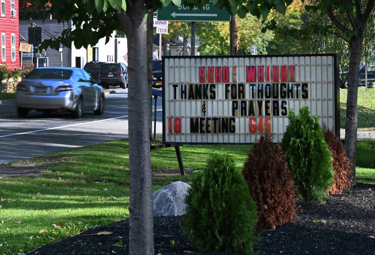 A sign thanking passersby for their thought and prayers stands in front of the SCHO Wright Ambulance service Wednesday Oct.10, 2018 in Schoharie, N.Y. (Skip Dickstein/Times Union)