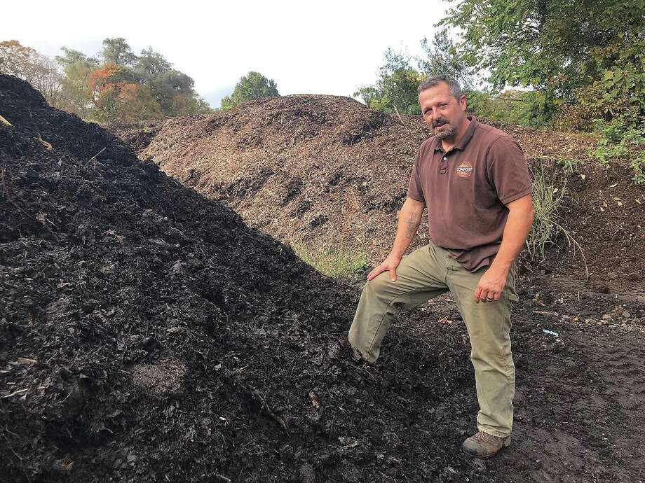 Jeff Demers, owner of New England Compost in Danbury, Conn., stands near a pile of compost made from leaves and other organic matter on Wednesday, Oct. 10, 2018. Several landscaping companies bring their leaves to New England Compost following fall lawn cleanups. Photo: Chris Bosak / Hearst Connecticut Media / The News-Times