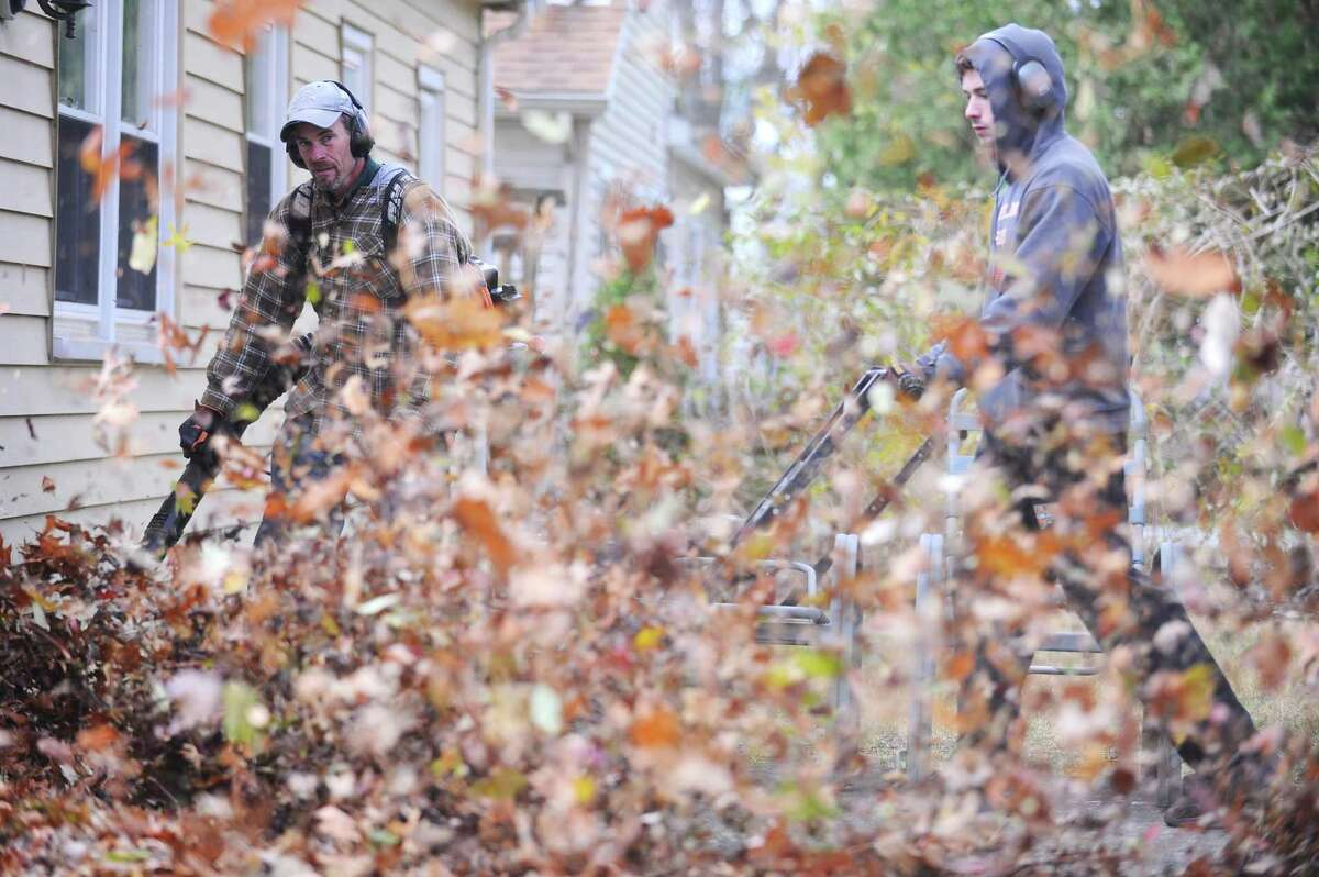 A crew from Stamford based Caretaker Landscaping blow leaves into a pile on Merriman Road for the city to pick up in Stamford, Conn. on Monday, Nov. 20, 2017.