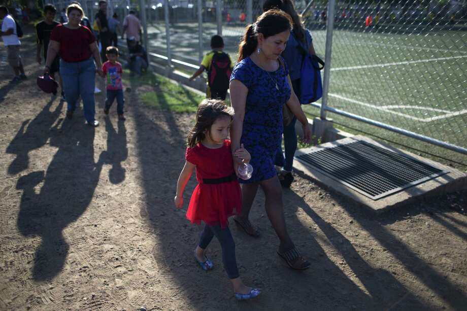 Araceli Ramos walks with her daugher, Alexa, in San Miguel, El Salvador. Before they were reunited, a U.S. judge gave full custody of the five-year-old girl to an American foster family. Photo: Rebecca Blackwell / Associated Press / Copyright 2018 The Associated Press. All rights reserved.