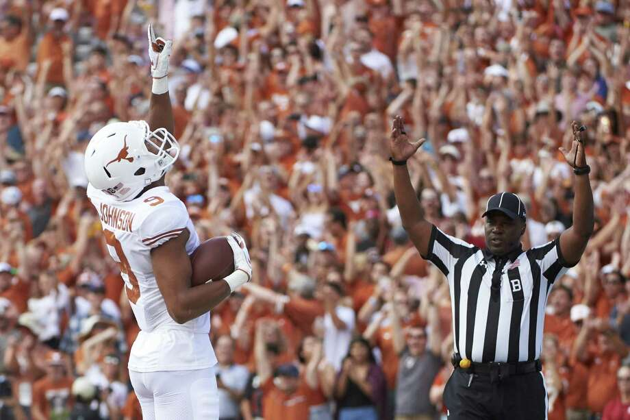 In this Saturday, Oct. 6, 2018, file photo, Texas wide receiver Collin Johnson (9) celebrates after scoring a touchdown on a 2-yard reception during the first half of an NCAA college football game against Oklahoma at the Cotton Bowl in Dallas. Johnson and LilJordan Humphrey have been a big problem for opposing defenses. The duo has combined for 65 catches and eight touchdowns for the No. 9 Longhorns. Photo: Cooper Neill, FRE / Associated Press / Copyright 2018 The Associated Press. All Rights Reserved.
