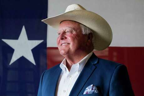 Texas Agriculture Commissioner Sid Miller stands in front of a Texas flag at Renard Group Advertising in Tyler, Texas, Thursday, July 12, 2018. Miller came to Tyler to speak to local agricultural leaders about the state of the Texas agricultural community. (Chelsea Purgahn/Tyler Morning Telegraph via AP)