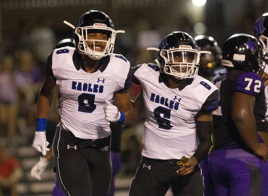 New Caney's Gerome Henry (8) reacts after scoring a 2-yard touchdown during the second quarter of a District 8-5A high school football game at Berton A. Yates Stadium, Friday, Sept. 14, 2018, in Willis. Photo: Jason Fochtman, Staff Photographer