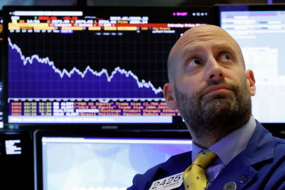 Specialist Meric Greenbaum works at his post on the floor of the New York Stock Exchange, Wednesday, Oct. 10, 2018. Stocks are extending their slump on Wall Street, led by drops in big technology companies, as rising bond yields draw investors out of stocks. (AP Photo/Richard Drew) Photo: Richard Drew, Associated Press / Copyright 2018 The Associated Press. All rights reserved