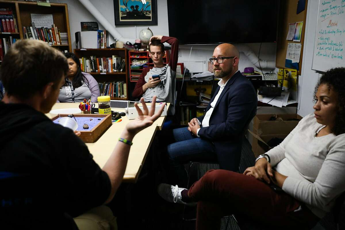 Supervisor Rafael Mandelman (center,right) converses Tyler Cook, 25, (left) during a tour of the Larkin Street Youth Services in San Francisco, California, on Thursday, Aug. 16, 2018.