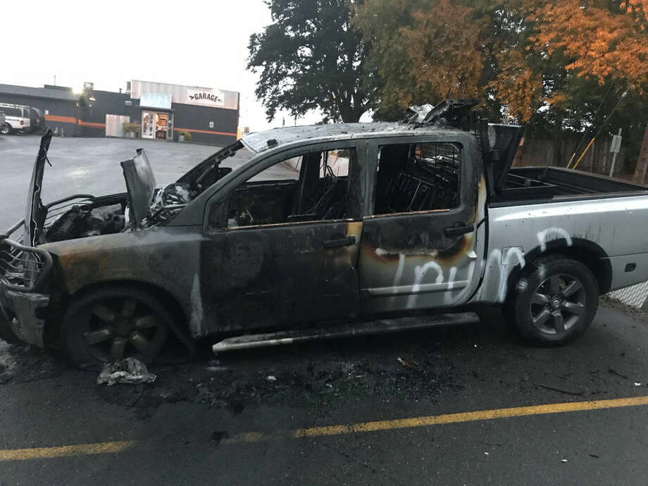 "Johnny MacKay left his Nissan truck parked at a bar in Vancouver, Washington overnight on Monday, Oct. 8, 2018. When he returned the next morning he found it had been set on fire and ""Trump"" had been spray-painted in white letters across the driver's side. MacKay told a local news station he had just put two bumper stickers on the truck the weekend before that read, ""TRUMP 2020"" and ""TRUMP: KEEP AMERICA GREAT! 2020."" >>Photos of the damage Photo: Johnny MacKay"