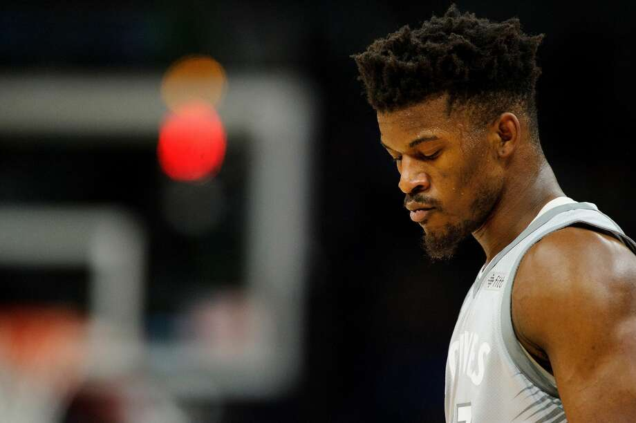 MINNEAPOLIS, MN - APRIL 11: Jimmy Butler #23 of the Minnesota Timberwolves looks on during the game against the Denver Nuggets on April 11, 2018 at the Target Center in Minneapolis, Minnesota. The Timberwolves defeated the Nuggets 112-106. With the Tomball High School product's status still unresolved, coach Tom Thibodeau and the Timberwolves head toward the season coming off the franchise's first playoff appearance in 14 years but carrying yet a still-cloudy outlook despite the super-max contract Karl-Anthony Towns. (Photo by Hannah Foslien/Getty Images) Photo: Hannah Foslien/Getty Images