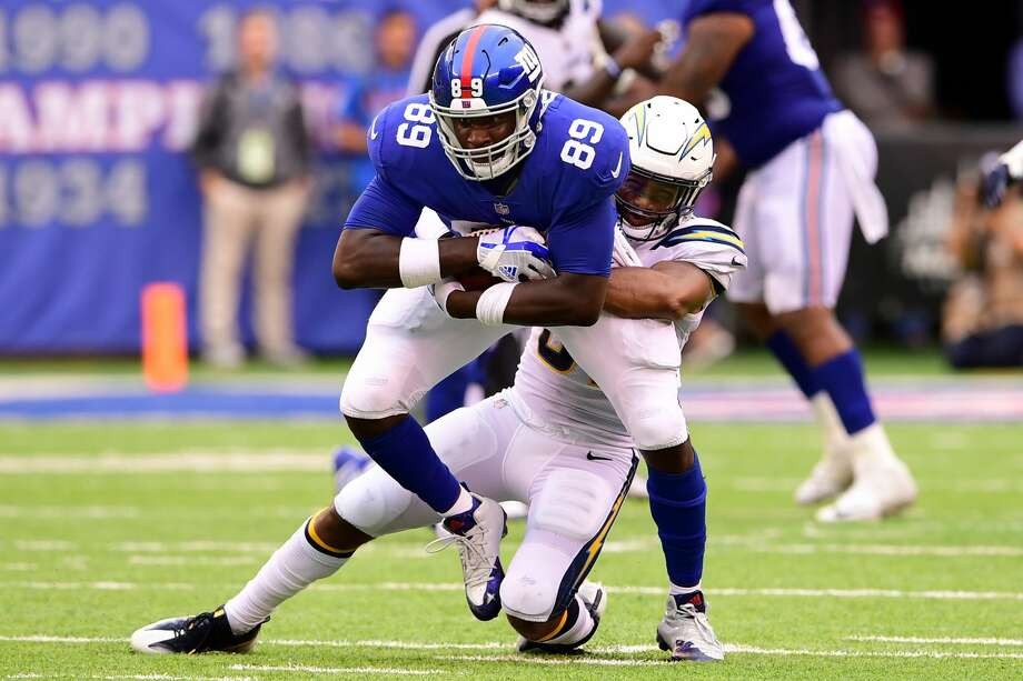 EAST RUTHERFORD, NJ - OCTOBER 08: Jerell Adams #89 of the New York Giants is tackled by Adrian Phillips #31 of the Los Angeles Chargers during an NFL game at MetLife Stadium on October 8, 2017 in East Rutherford, New Jersey. The Los Angeles Chargers defeated the New York Giants 27-22.  (Photo by Steven Ryan/Getty Images) Photo: Steven Ryan/Getty Images