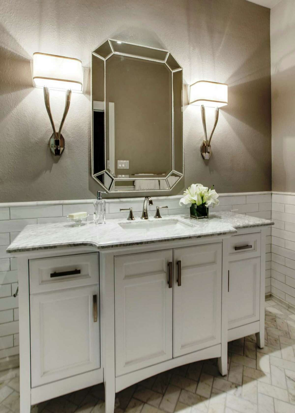 For high-end bathrooms, the furniture look can be made in styles from the ornate to contemporary. While ready-made, furniture-style vanities are available, considerations such as size and style mean they must often be custom or else semi-custom made. A larger size cabinet measuring 48 inches, but without the sink, faucet and countertop, would cost about $2,000 to design, fabricate and install, according to Jana Valdez, co-owner of Haven Design and Construction.