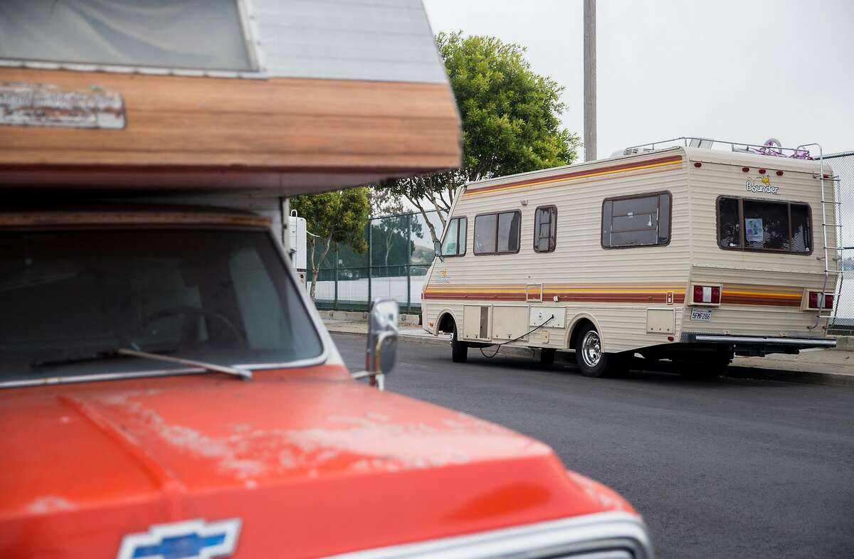 Multiple RVs are seen parked along University Street near the North Basin reservoir in the Portola neighborhood of San Francisco, Calif. Tuesday, Oct. 9, 2018.