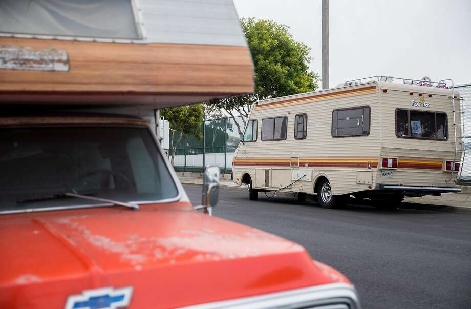 RVs and campers are parked along University Street near the North Basin reservoir in the Portola neighborhood. Photo: Jessica Christian / The Chronicle