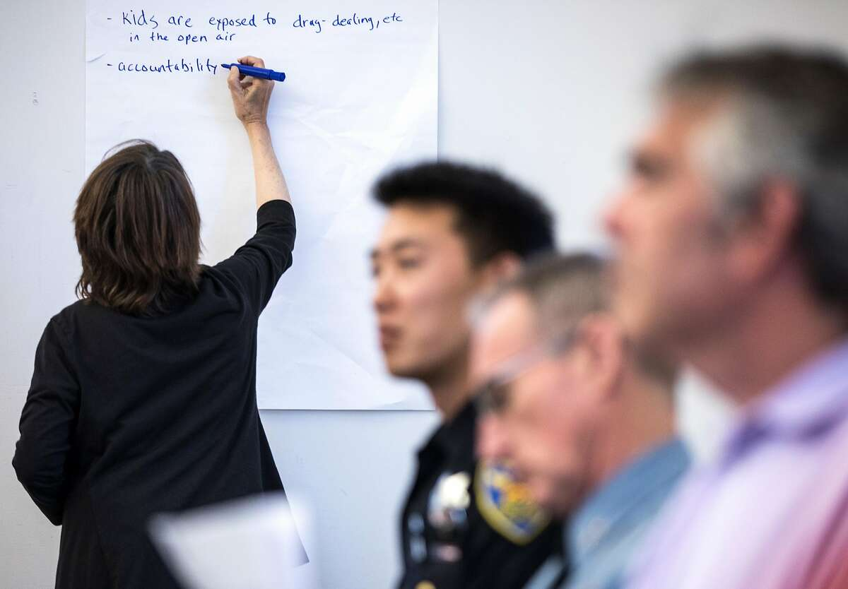 A secretary takes notes as residents share their concerns during a community meeting surrounding RV and commercial vehicle parking issues in the Portola neighborhood of San Francisco, Calif. Tuesday, Oct. 9, 2018.
