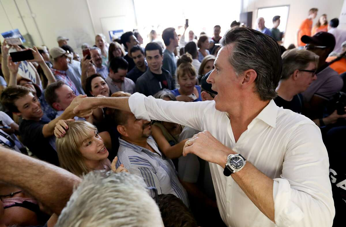 FILE - In this Sept. 15, 2018, file photo, California gubernatorial candidate, Lt. Gov. Gavin Newsom, a Democrat, greets supporters after a campaign stop in Tustin, Calif. California's race for governor pits Newsom, a Democrat and former San Francisco mayor, against Republican businessman John Cox. (AP Photo/Chris Carlson, File)
