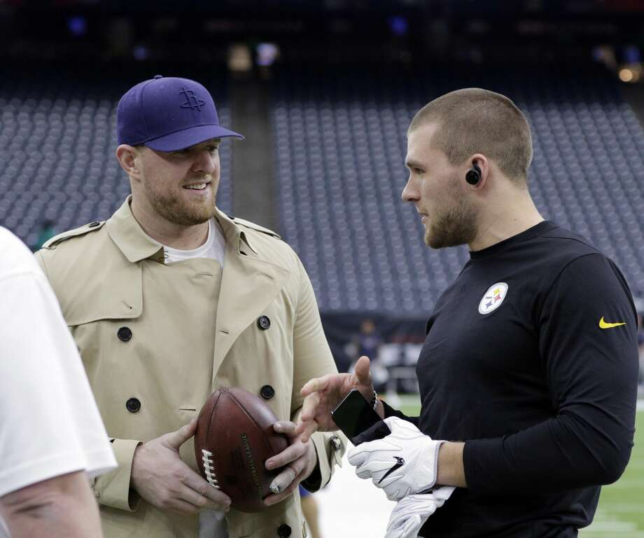 Pittsburgh Steelers outside linebacker T.J. Watt, right, talks with his brother, Houston Texans defensive end J.J. Watt, left, before an NFL football game Monday, Dec. 25, 2017, in Houston. (AP Photo/Michael Wyke) Photo: Michael Wyke/AP
