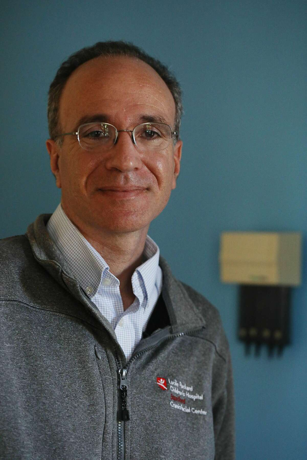 Dr. Jon Bernstein, pediatric medical director for Stanford Center for Undiasgnosed Disease, stands for a portrait at Luciele Packard Children's Hospital Outpatient Clinic on Wednesday, October 10, 2018 in Stanford.