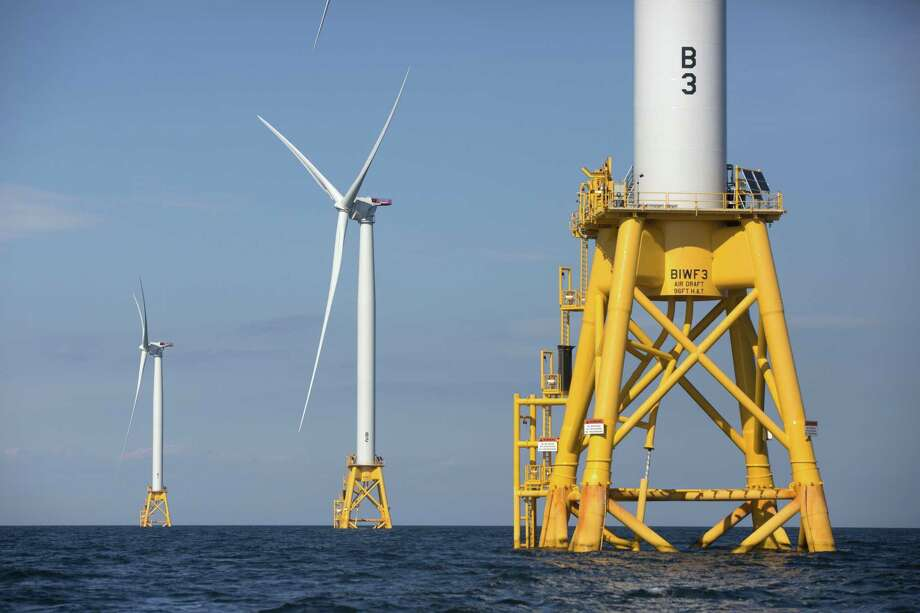 Three of Deepwater Wind's turbines stand in the water off Block Island, R.I. Photo: Michael Dwyer / Associated Press File / Copyright 2016 The Associated Press. All rights reserved
