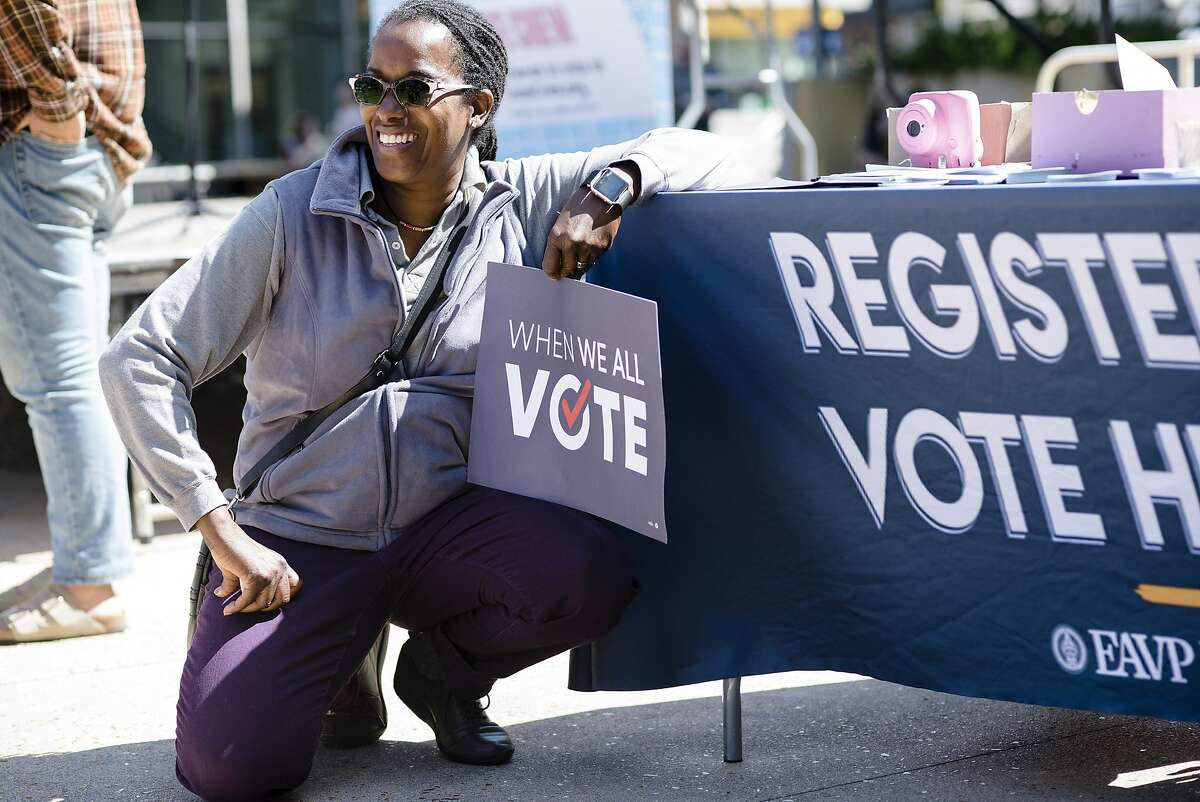 Assembly District 15 candidate Jovanka Beckles poses with a sign after giving a speech during a VoteCrew event encouraging students to vote during National Voter Registration Day on the UC Berkeley campus in Berkeley, Calif., on Tuesday September 25, 2018