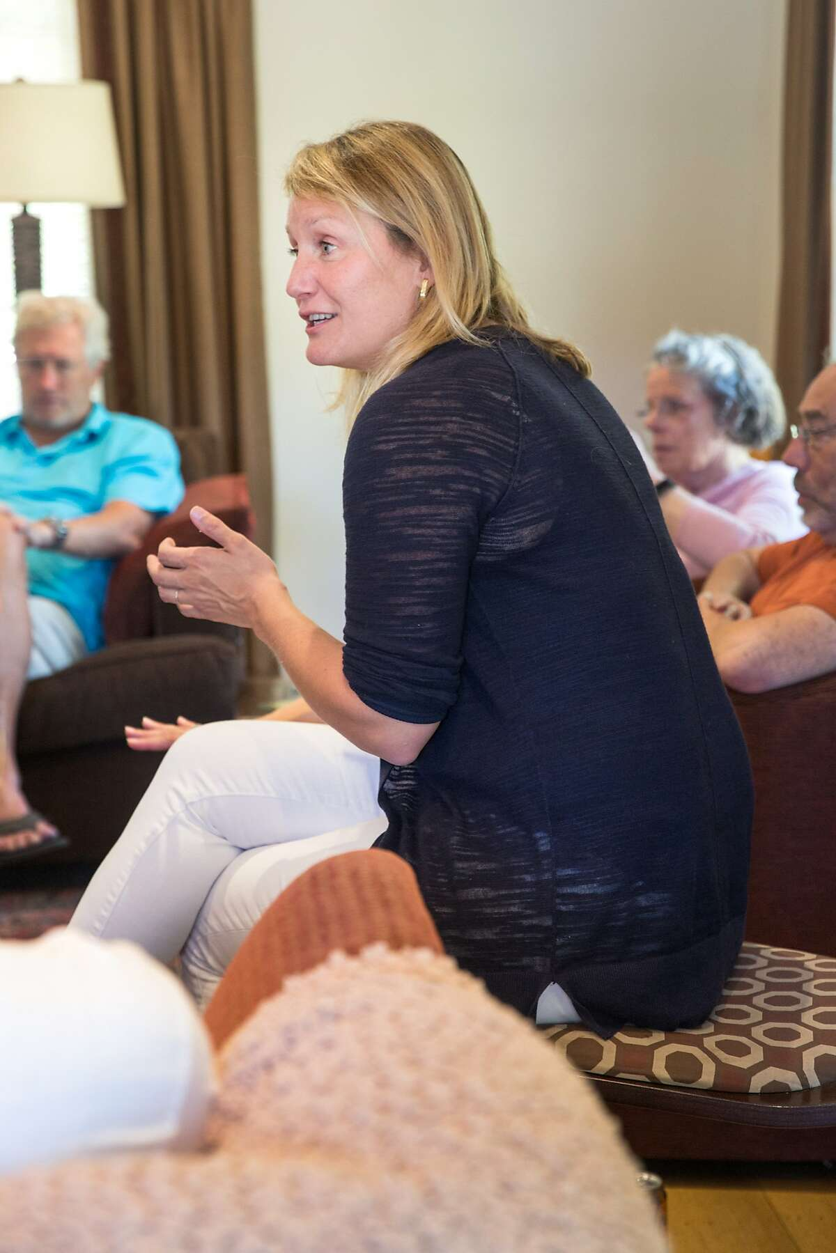 Buffy Wicks, a candidate for the 15th State Assembly district, talks with supporters during a house party hosted by Carmen Murray, leader in the local Organizing For Action group. On Sunday, October 7, 2018 in Oakland Calif.