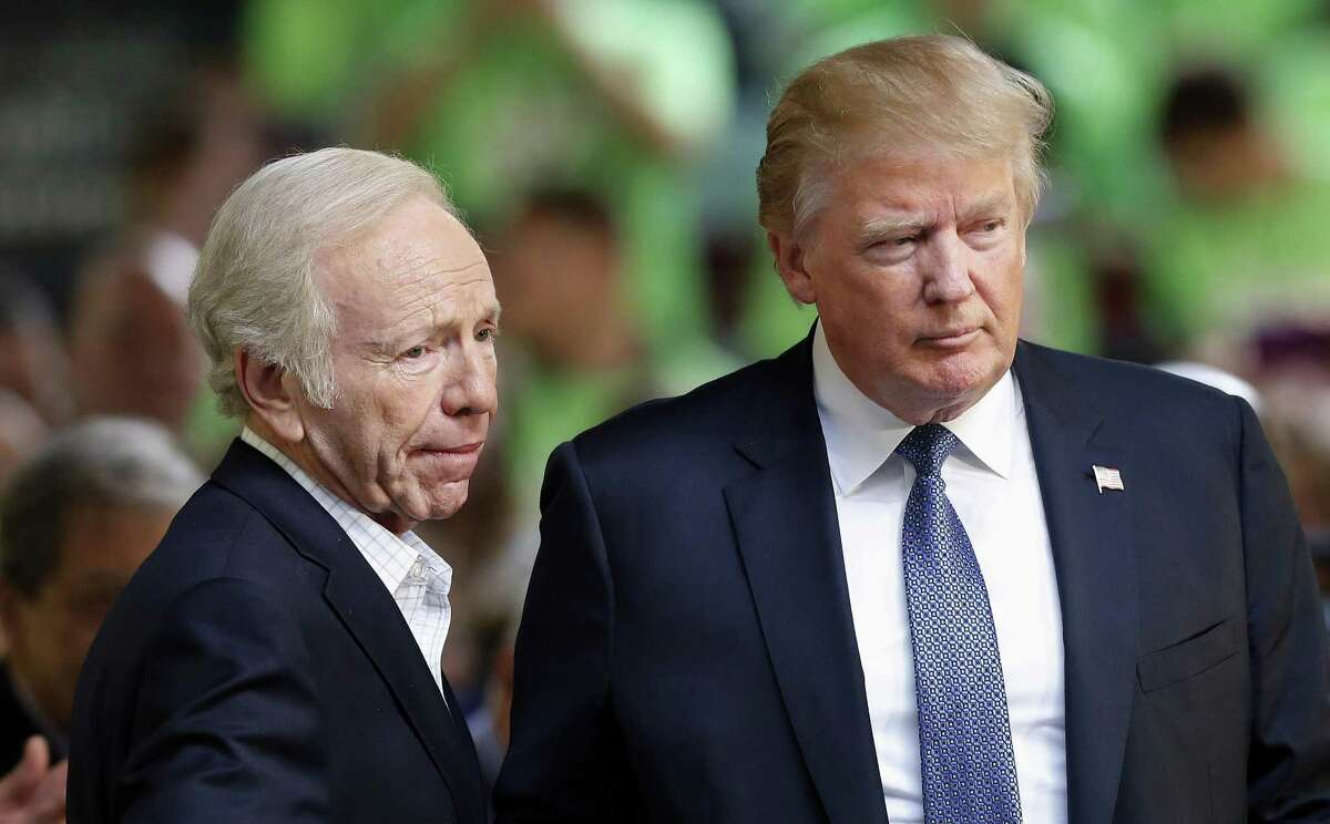 Former Democratic vice presidential candidate, former Connecticut Sen. Joe Lieberman, an No Labels co-chairman, introduces Republican presidential candidate Donald Trump to speak at a No Labels Problem Solver convention, Monday, Oct. 12, 2015, in Manchester, N.H.