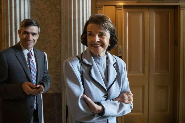 Sen. Dianne Feinstein, D-Calif., right, smiles at a reporter before the Democratic policy luncheon on Capitol Hill, Wednesday, Oct. 10, 2018 in Washington. (AP Photo/Alex Brandon)