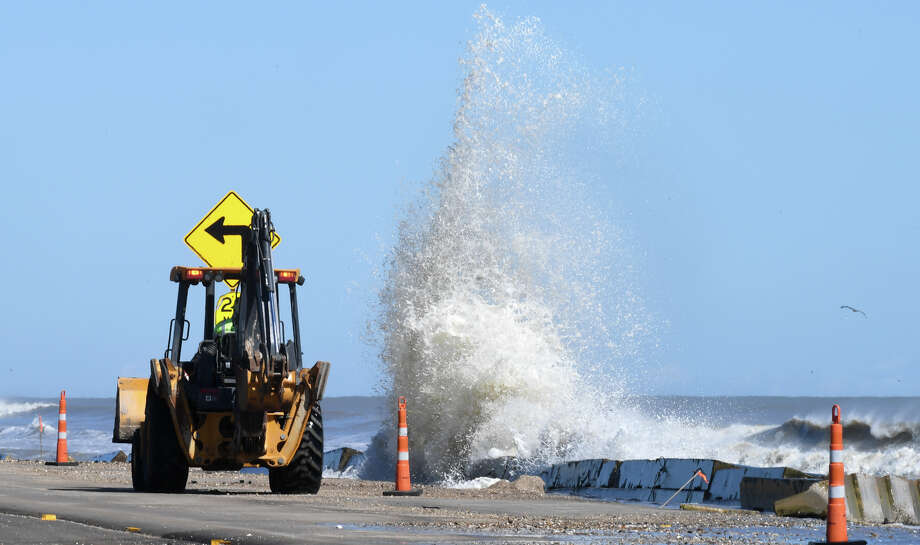 Huge waves created by Hurricane Michael crash into cement barricades along Texas 87 on Bolivar Peninsula Wednesday. Photo taken Wednesday, 10/10/18 Photo: Guiseppe Barranco/The Enterprise / Guiseppe Barranco ©