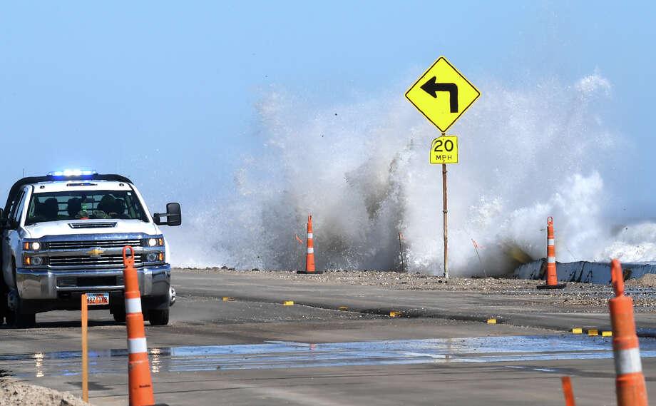 Huge waves created by Hurricane Michael crash into cement barricades along Texas 87 on Bolivar Peninsula Wednesday. Photo taken Wednesday, 10/10/18 Photo: Guiseppe Barranco/The Enterprise / Guiseppe Barranco ?