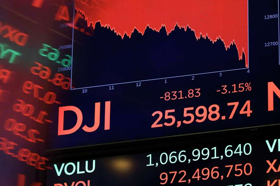 A screen above the floor of the New York Stock Exchange shows the closing number of the Dow Jones industrial average, Wednesday, Oct. 10, 2018. The Dow Jones Industrial Average plunged more than 800 points, its worst drop in eight months, led by sharp declines in technology stocks. (AP Photo/Richard Drew) Photo: Richard Drew / Copyright 2018 The Associated Press. All rights reserved