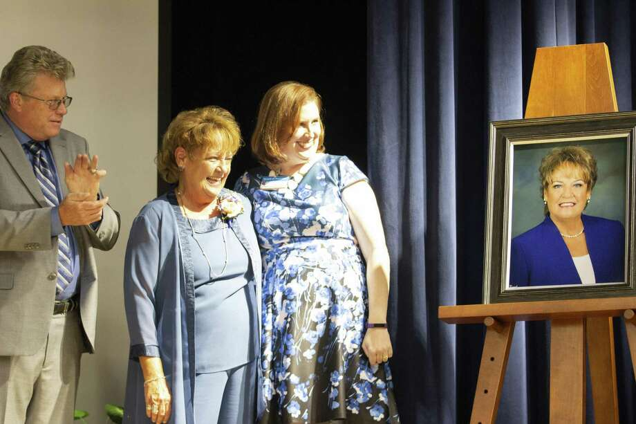 Katherine Clark, center, her husband Gary Clark and Conroe Independent School District school board president Melanie Bush reactto the unveiling of Katherine Clark's portrait during a dedication ceremony for Clark Intermediate School on Tuesday, Oct. 9, 2018 in Spring, TX. Photo: Cody Bahn, Houston Chronicle / Staff Photographer / © 2018 Houston Chronicle