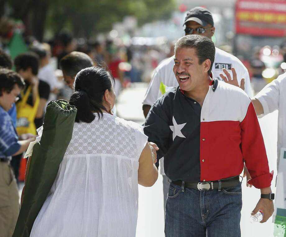 Adrian Garcia shakes hands during the 50th Annual Houston Fiestas Patrias Parade Saturday, Sept. 15, 2018, in Houston. The longtime politician and law enforcement officer is challenging Precinct 2 incumbent Jack Morman for the post on Harris County Commissioners Court. Photo: Steve Gonzales, Houston Chronicle / Staff Photographer / © 2018 Houston Chronicle