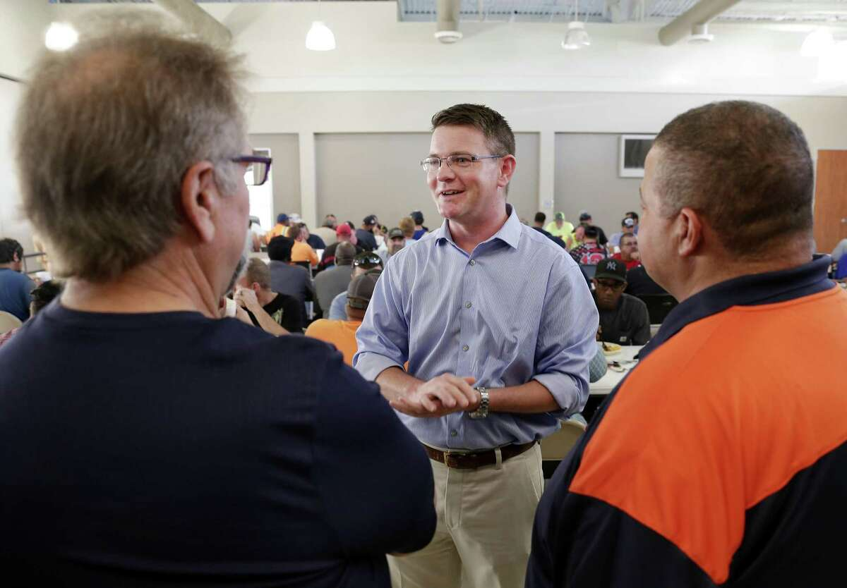 Precinct 2 incumbent commissioner Jack Morman, center, talks with union members Vince Lampasas Jr., left, and Victor Bass, right, before a meeting of ILA Local 28 members at the meeting hall Wednesday, Oct. 3, 2018 in Pasadena, TX. He faces a challenge from Adrian Garcia in the November general election.