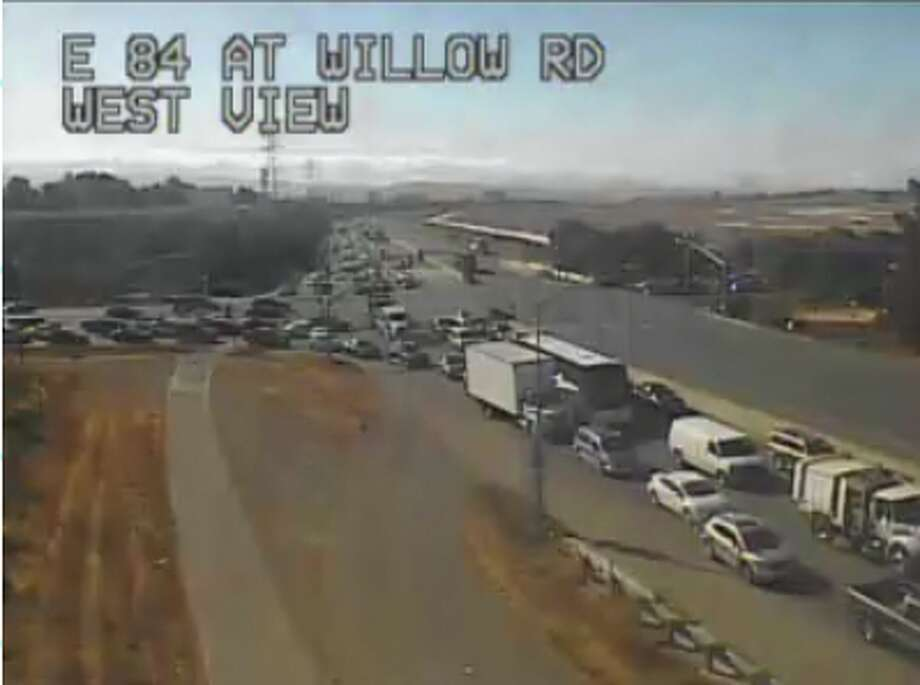 Cars line up in a traffic backup near Facebook's headquarters heading eastbound on Highway 84. A Facebook bus collided with a truck around 2 p.m. Wednesday. Photo: Caltrans Traffic Cam