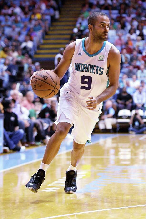 CHAPEL HILL, NC - SEPTEMBER 28: Tony Parker #9 of the Charlotte Hornets moves the ball against the Boston Celtics in the first quarter of a preseason game at Dean Smith Center on September 28, 2018 in Chapel Hill, North Carolina. NOTE TO USER: User expressly acknowledges and agrees that, by downloading and or using this photograph, User is consenting to the terms and conditions of the Getty Images License Agreement. The Hornets won 104-97. (Photo by Lance King/Getty Images) Photo: Lance King / Getty Images / 2018 Lance King